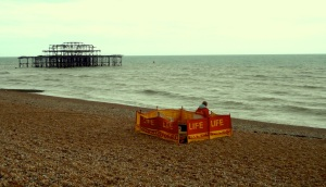 Photo of lifeguard, empty beach and burnt west pier