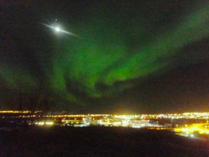 Aurora over Reykjavik as seen from Öskjuhlíð hill